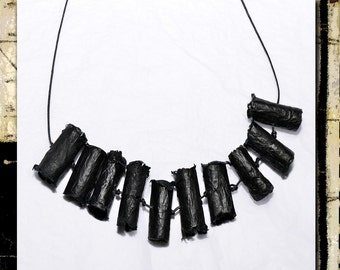 Necklace made with hardened tissue paper