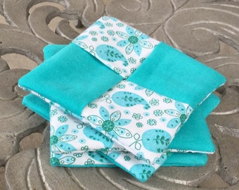 Set of four blue and white coasters