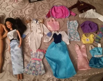 Kira barbie and Ken doll plus clothing lot