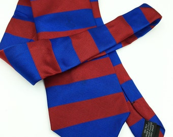 Paolo Gucci Mens Necktie in a classic red and blue stripe pattern.