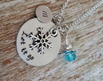 Let it go hand stamped necklace / Snowflake charm necklace / Winter wonderland jewelry / little girl's necklace / frozen party favors