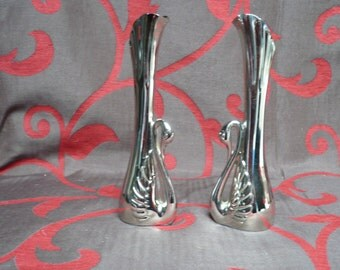 Two silverplated, heavy little vases, little swans