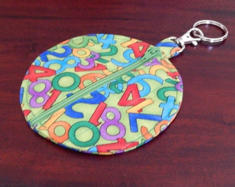 Scrambled numbers on small zip purse for keyring