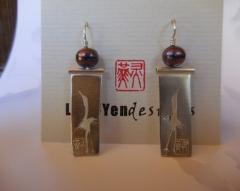 Crane earring in sterling silver with pearls
