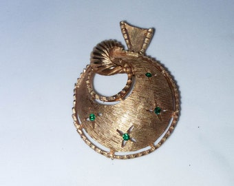 Goldtone brooch with green stones