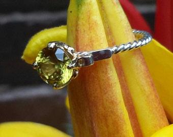 On *SALE* Distinctive & Feminine  Natural Sphene Ring .