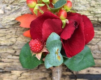 wedding corsage.buttonhole Deep red, hydrangea, berries.foliage leaves