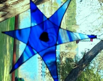 Cobalt blue stained glass star / sun-catcher with bead heart on center.