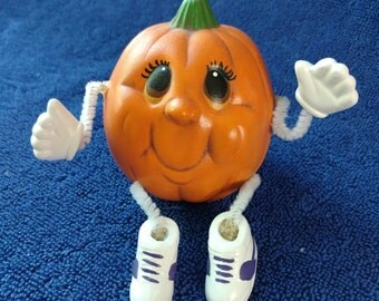 Smiling Pumpkin Head with movable arms and legs