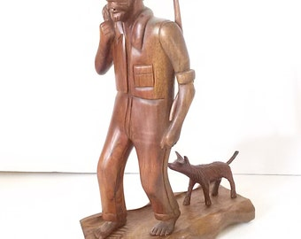 Hand Carved Woodsman Returning From The Hunt