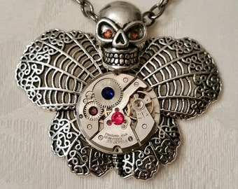 Steampunk Skull Butterfly Necklace with watch movement and Swarovski crystals.