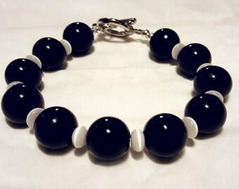 White cat's eye and black beaded bracelet
