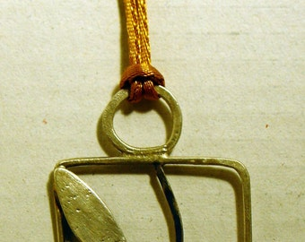 Silver Pendant and wood