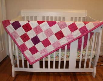 Crib Size Baby Quilt with Various Pinks