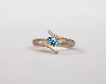 9ct Red Gold and Sterling Silver Mokume Gane ring with a Faux-tension set Aquamarine