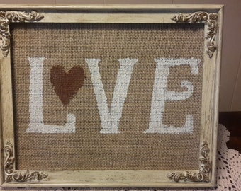 Love stenciled on burlap
