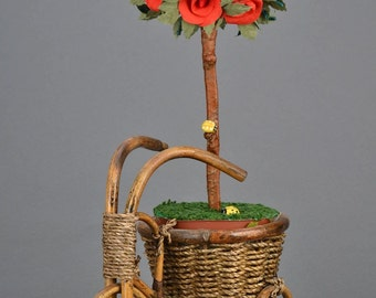 Handmade topiary with red flowers