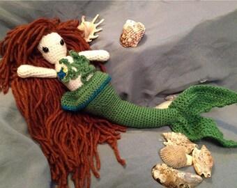 Crocheted mermaid doll. Amigurumi mermaid with seaweed and starfish detail