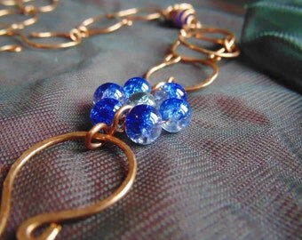 Copper Necklace with blue embelishments.