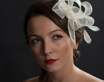 Ivory bridal fascinator with feathers and swarovski pearls