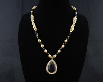 Golden and black beads necklace with pendant