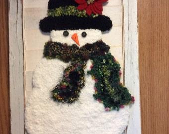 Snowman on a  shutter