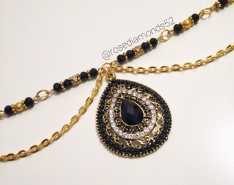 Gold and black headpiece