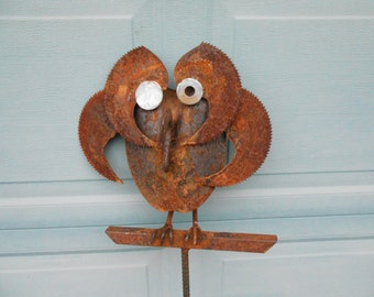 rusty metal garden art owl