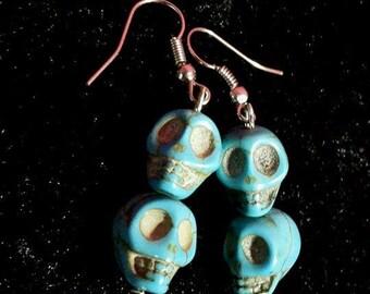 Earrings blue skulls