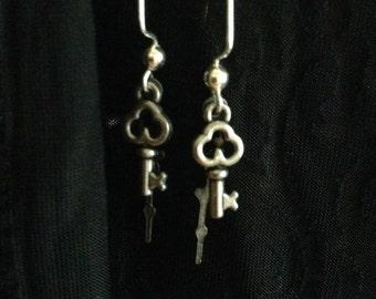 Key and clock hand earrings