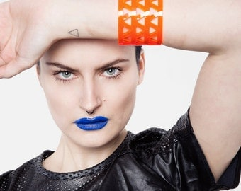 Lucite neon orange bracelet, minimal perspex cuff.