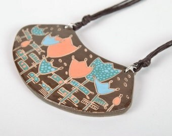 Ceramic pendant with a cord