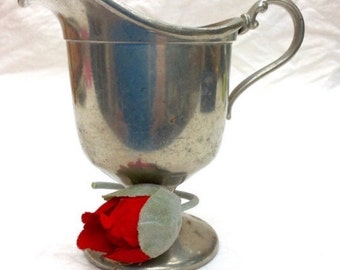 Antique Early 1900's footed Pewter creamer. Marked W.S. Company.