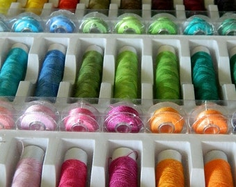 Lot of 64 spools of thread sewing multi use colorful polyester