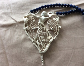 silver lace pendant gemmakt to the example of Art Nouveau style.