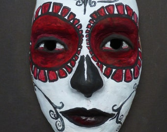 hand painted ceramic mask inspired by the day of the dead and created by portrait artist Anita Dewitt