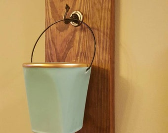 Wall vase or candle holder.