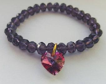 Purple bead bracelet with pink swarovski heart
