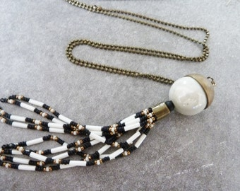 ethnic necklace bronze and Pompom beads ecru and black