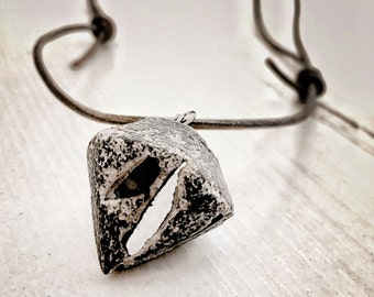 Striking diamond shaped concrete, mirror glass pendant and leather cord statement necklace