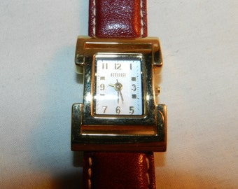 Beautiful Ecclissi Gold-Tone rectangular ladies watch - Needs battery to run - for Found / Altered / Mixed Media Art or to wear        23-32