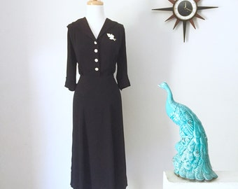 1940s black crepe dress with milk glass buttons.