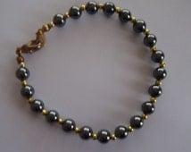 Vintage Polished Hematite Bracelet Dark Silver Grey Beads with Gold Tone Separators and Clasp 7 1/2 inches (19 cm) Long