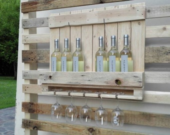 Door in wine bottles and glasses small pallet