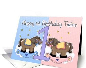 Twins First Birthday Card - Two Little rocking horses, pink rocking horse, blue rocking horse, twins first birthday