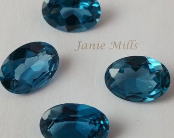 Blue Zircon faceted 13 x 18mm oval