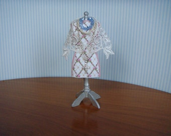 1/12th miniature scale silver stand with a rose pink dress  with a lace shawl.