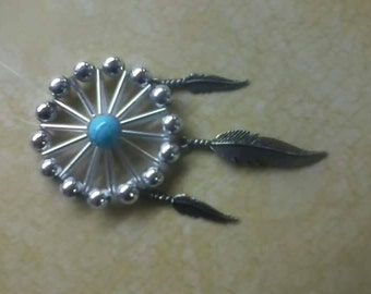 Simply silver feather pendant.
