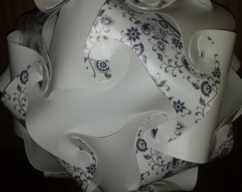 Fully assembled blue flower and white puzzle light.