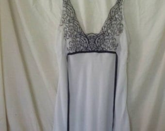 Embroidered white slip